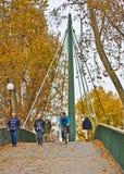 Stuttgart, Germany - People cross pedestrian bridge on working d Royalty Free Stock Photos
