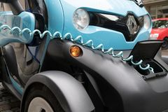 Bright blue and black micro-car Renault Twizy recharging on Stut. STUTTGART, GERMANY - SEPTEMBER 12 2017; Bright blue and black micro-car Renault Twizy Stock Image