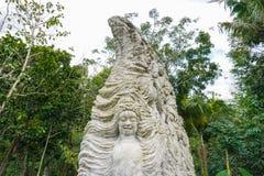Stutue i den sakrala apaskogen, Ubud, Bali, Indonesien, 09 08 2019 royaltyfria foton
