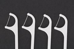 Stuzzicadenti del filo per i denti Immagini Stock
