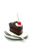 Stycke av den chokladkakan och gaffeln med vit bakgrund Royaltyfria Foton