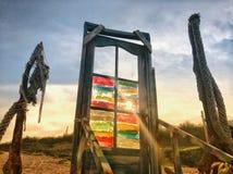 Stycke av konst i mitt av stranden Fotografering för Bildbyråer