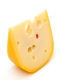 Stycke av ost som isoleras på vit Arkivfoto