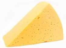 Stycke av ost som isoleras på white Royaltyfria Foton