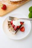 Stycke av syrliga jordgubbar Fotografering för Bildbyråer