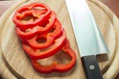 Stycke för söta peppar på köksbordslut upp Fotografering för Bildbyråer