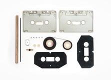 Stycken av den analoga kassetten på vit bakgrund royaltyfri fotografi