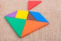 Stycken av ett fyrkantigt tangrampussel Royaltyfri Foto