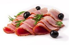 Stycken av kött med oliv Fotografering för Bildbyråer