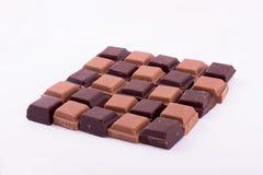 Stycken av mörker och mjölkar choklad Fotografering för Bildbyråer
