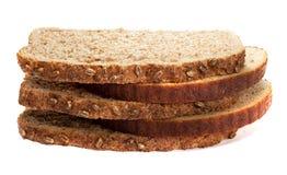 Stycken av olikt bröd som isoleras på vit bakgrund Royaltyfria Bilder