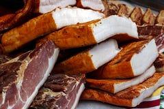 Stycken av rökt griskött bacon-1 Royaltyfri Foto