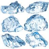 Stycken av is som isoleras på vit Med den snabba banan fotografering för bildbyråer