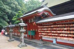 Stycken av träplattor för att välsigna i den Dazaifu tenmangurelikskrin Royaltyfri Bild