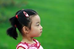 stygg barnkines royaltyfria bilder