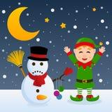 Stygg jul älva och snögubbe Arkivbild