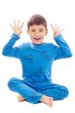 Stygg pojke i pyjamas på vit bakgrund Fotografering för Bildbyråer