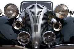 Style. A vintage black car with lights and chrome horn stock image