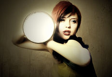 Style art photo of a sexy young woman with light Stock Photography
