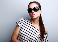 Style beautiful female model in fashion sunglasses posing Royalty Free Stock Photography