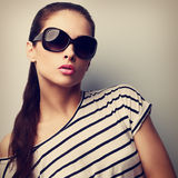 Style beautiful female model in fashion sunglasses. Retro portra Royalty Free Stock Images