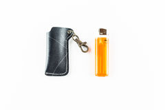 Style  of black  lighter cover and orange lighter Royalty Free Stock Photography