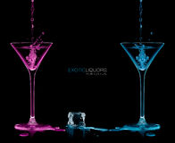 Style and Celebration Concept. Two Cocktail Glasses with Colorfu. Ice cube between two cocktail glasses filled with blue and pink alcoholic exotic liqueur Royalty Free Stock Images