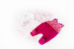 Style for a cute baby girl. Pink clothes for babygirl isolated on white background Stock Photos