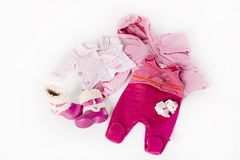 Style for a cute baby girl. Pink clothes for babygirl isolated on white background Royalty Free Stock Photos