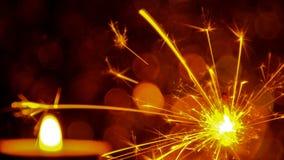 Style d'image de tache floue Noël et la nouvelle année font la fête la lumière de cierge magique et de flamme de bougie Images libres de droits