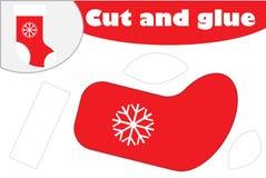 Style de bande dessinée de botte, jeu d'éducation de Noël pour le développement des enfants préscolaires, ciseaux d'utilisation e illustration de vecteur