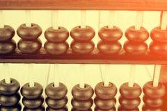 Style de vintage - fermez-vous des perles en bois d'un abaque Foc sélectif Image stock