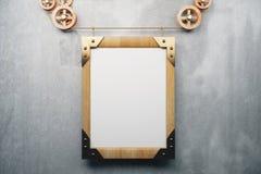 Style en bois vide de steampunk de cadre de tableau sur le mur en béton gris Image stock