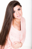 Style and fashion concept - happy young woman in pink sweater Stock Image