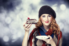Style girl with cake and bokeh at background. Royalty Free Stock Photography