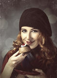 Style girl with cake and bokeh at background. Stock Images