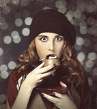 Style girl with cake and bokeh at background. Royalty Free Stock Photos