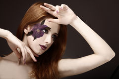 Style girl with makeup and violet flower. Royalty Free Stock Photos
