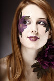 Style girl with makeup and violet flower. Royalty Free Stock Images