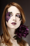 Style girl with makeup and violet flower. Stock Photo
