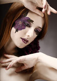 Style girl with makeup and violet flower. Stock Image