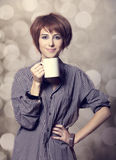 Style girl in shirt with cup at studio. Stock Photo