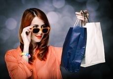 Style girl with shopping bags on gray background stock images