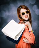 Style girl with shopping bags on gray background stock photo