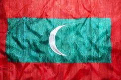Style grunge de drapeau des Maldives sur le mur de briques Images stock