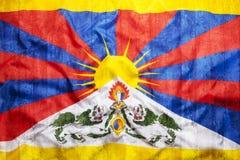 Style grunge de drapeau du Thibet sur le mur de briques Image libre de droits