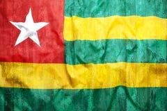 Style grunge de drapeau du Togo sur le mur de briques Image stock