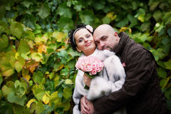 Style happy bride and groom in autumn park royalty free stock photography