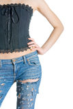 Style of hippies. Young girl in the torn jeans in the style of hippies Royalty Free Stock Image