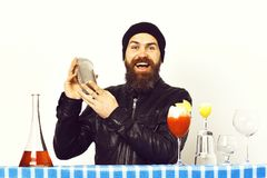 Style holding shaker and glasses of alcoholic cocktails with shot on blue checkered plaid isolated on white background. Bearded man, long beard. Brutal stock photo
